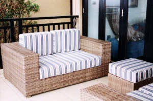 All weather, outdoor two seater sofa.
