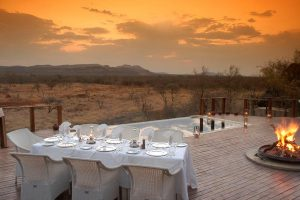 Luxury safari dinner with makuti arm chairs.