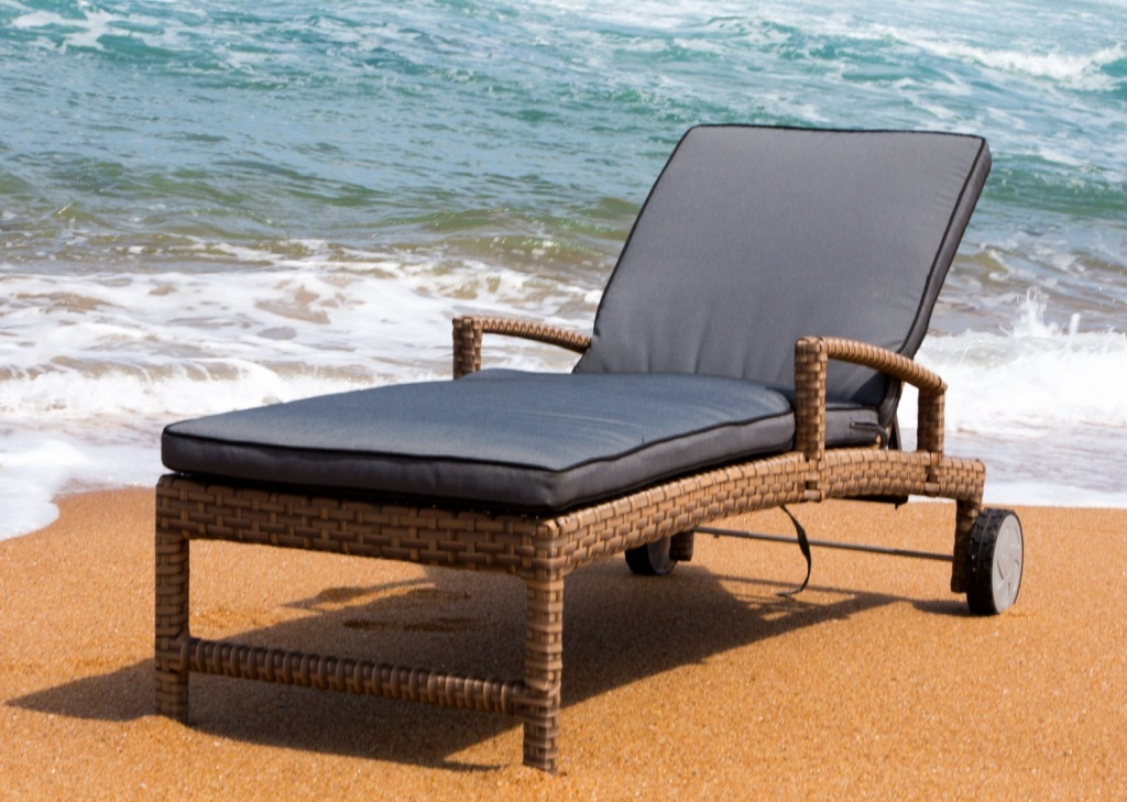 All weather outdoor lounger with wheels and adjustable back plus ottoman.