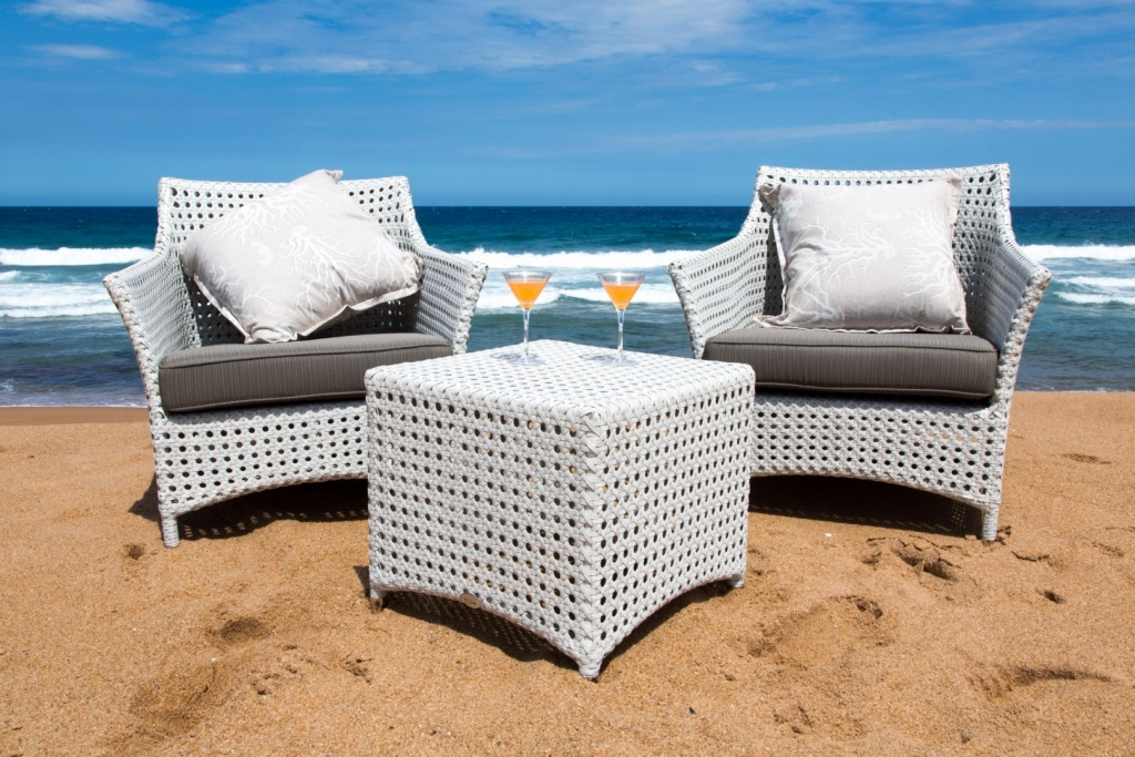 All weather outdoor Elita armchair and ottomans.