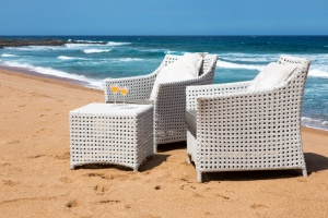All weather outdoor Elita arm chair and ottomans.