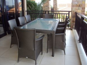 Malindi 6 - 8 seater dinning table with toughened glass inlay.