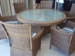 Round table with toughed glass inlay.