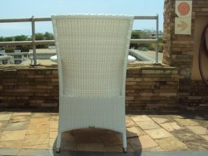 Single weaved white outdoor armchair.