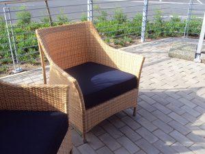 Single weaved Elita armchairs in honey wicker.