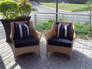 Single weaved Elita armchairs in honey wicker.