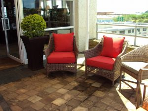 Special weaved Elita armchairs in coffee cream.