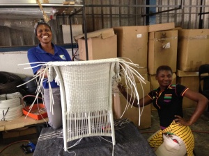 Two happy ladies weaving the Makuti armchair.