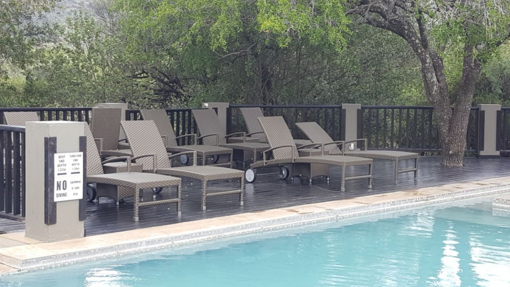 All weather outdoor loungers with wheels and adjustable back plus ottoman.