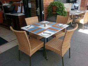 Single weaved Barnett dining chairs in honey wicker.