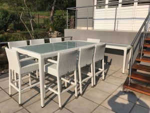Outdoor bar chairs in white.