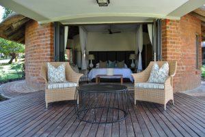Single weaved Makuti armchairs in honey wicker.